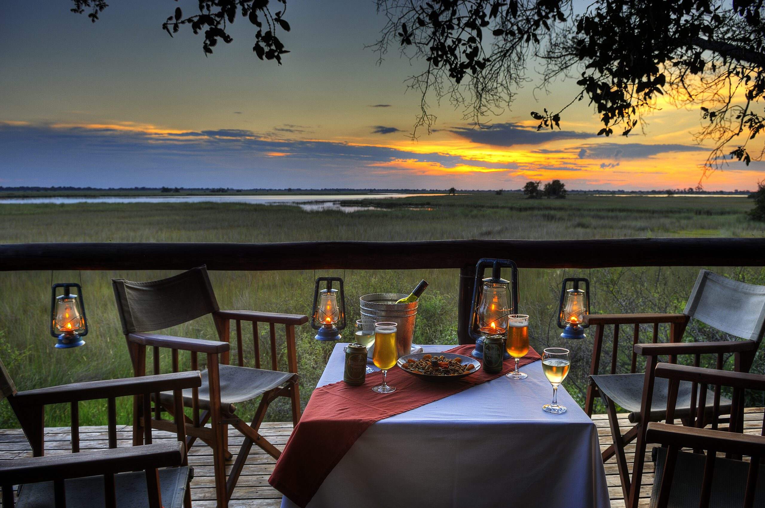 sunset at camp moremi with deck view and drinks on our best Botswana safari