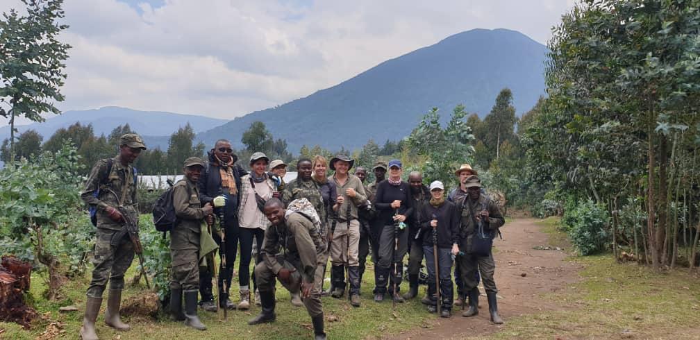 trekking group with guides posing before gorilla trek during safari in Rwanda