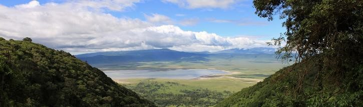 views into the Ngorongoro Crater with blue skies and white puffy clouds