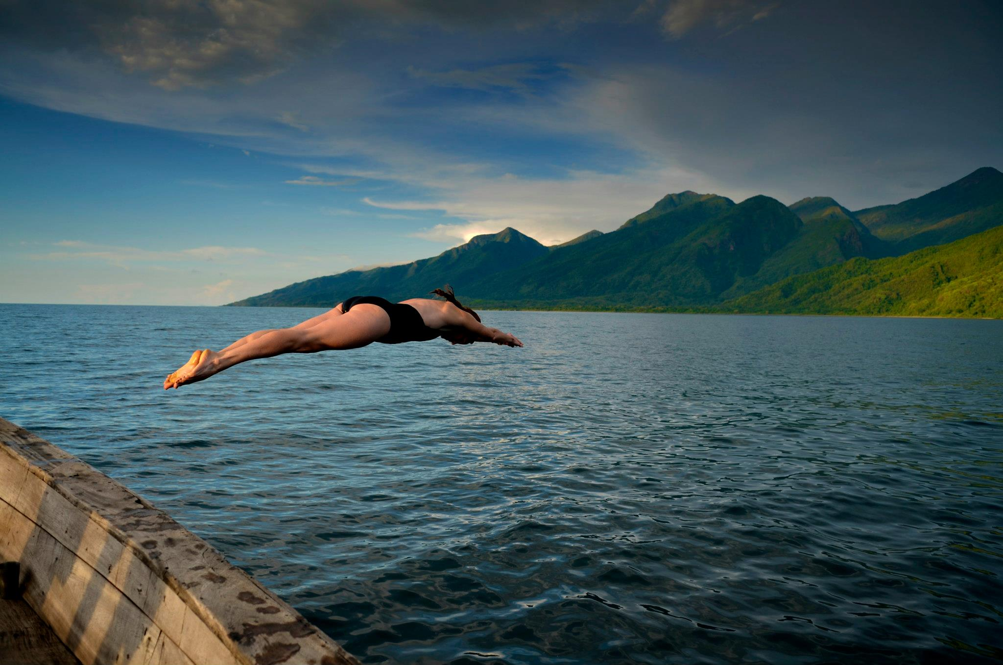 Kim diving into Lake Tanganyika with the Mahale Mountains in the background