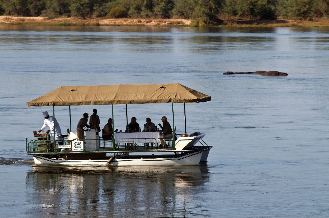 people eating lunch on a boat in the Lower Zambezi