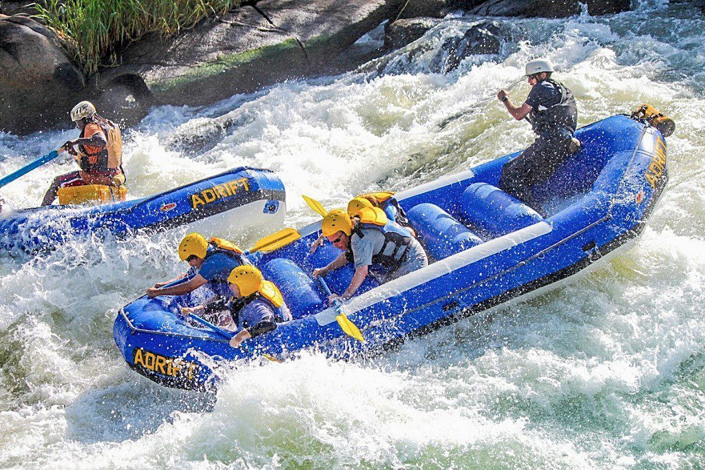two blue rafts forging through the rapids on the Nile River in Uganda