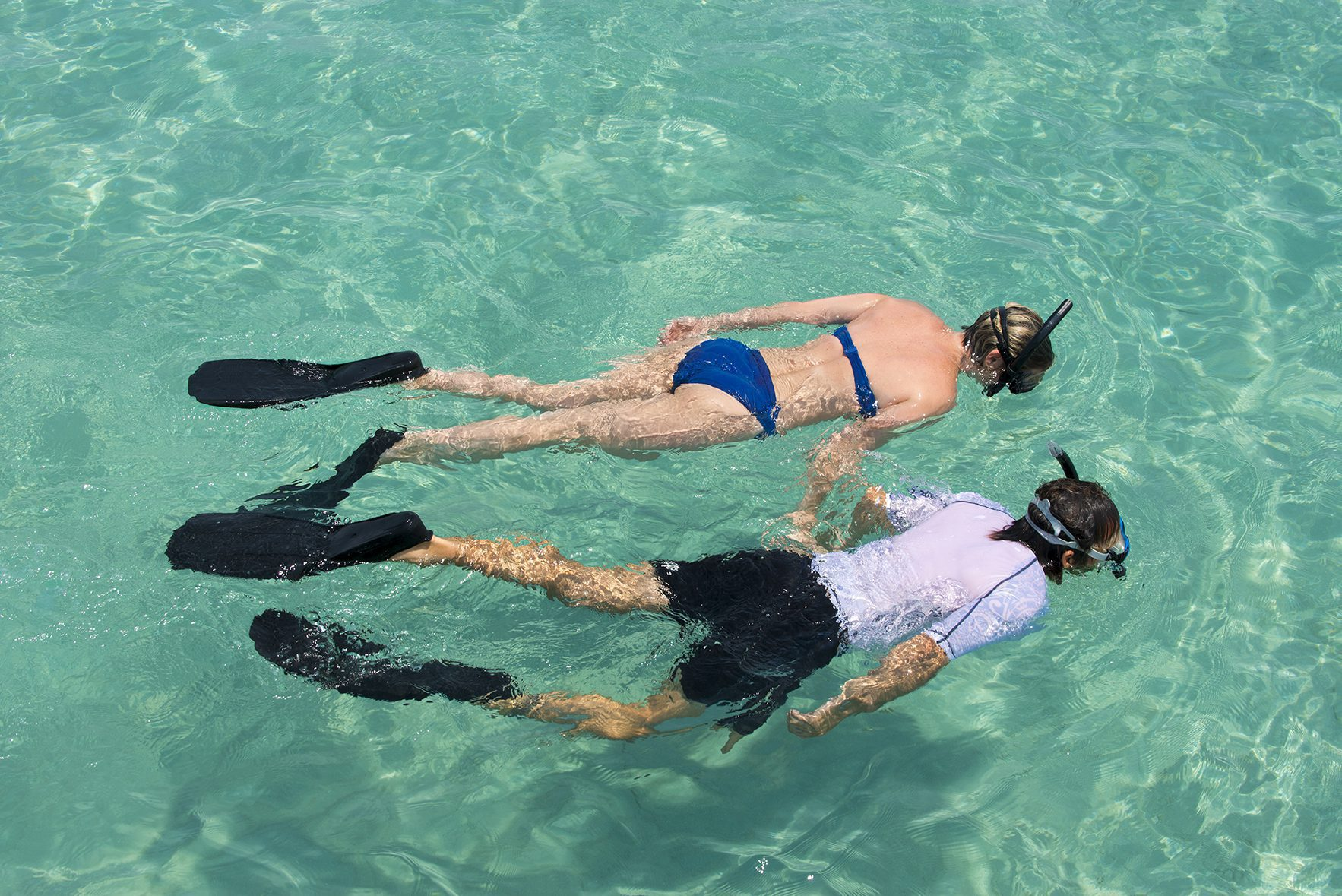 Mozambique couple snorkeling on Mexico holiday