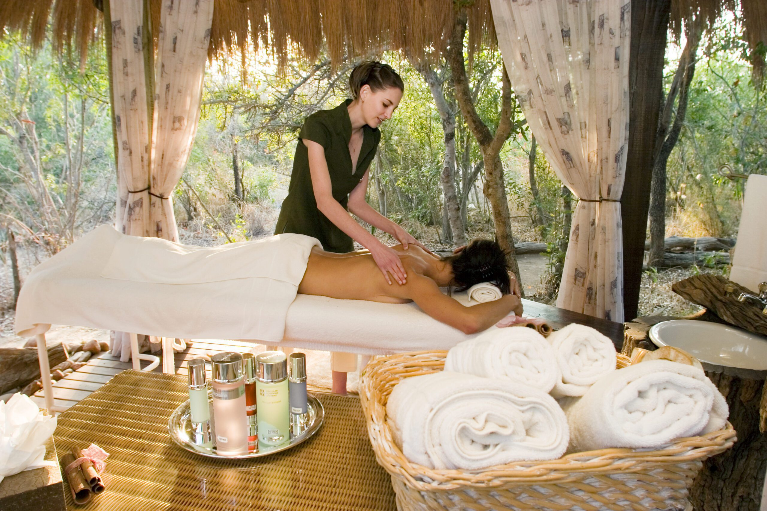 woman massaging a woman in a spa