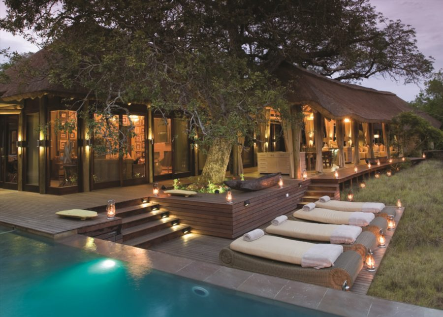 main lodge deck at phinda homestead at dusk with lanterns glistening and pool lit up