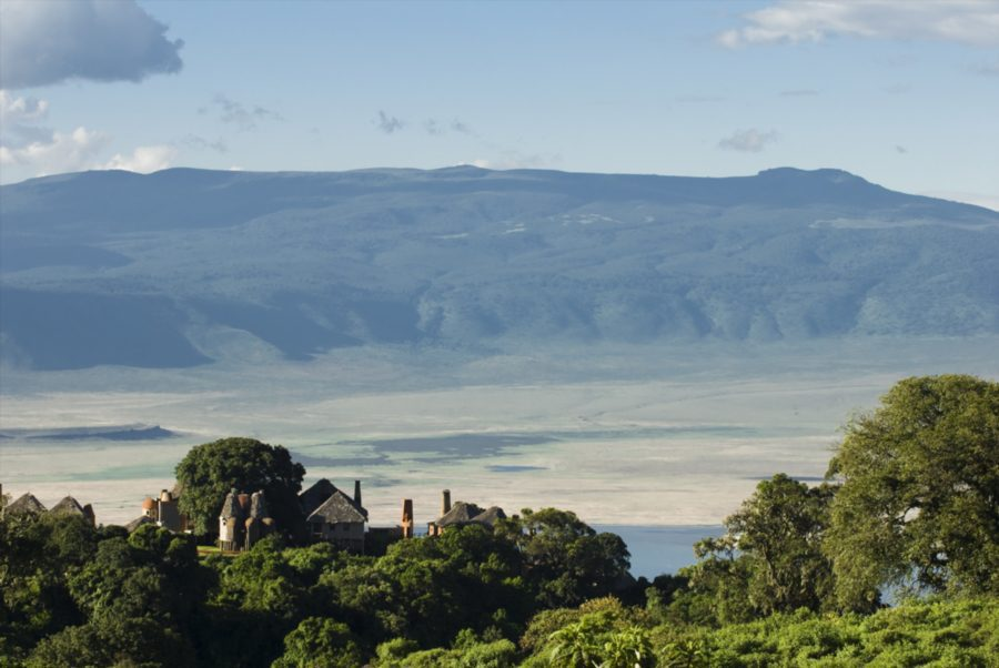distant views into the Ngorongoro Crater with a lodge tucked into the trees along the rim