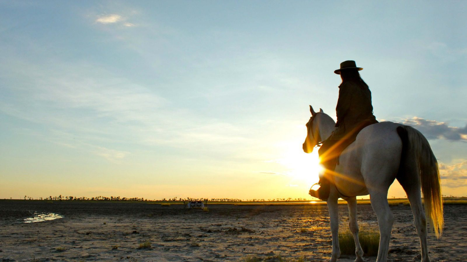 Horseback during sunset at Camp Kalahari on our best botswana safari