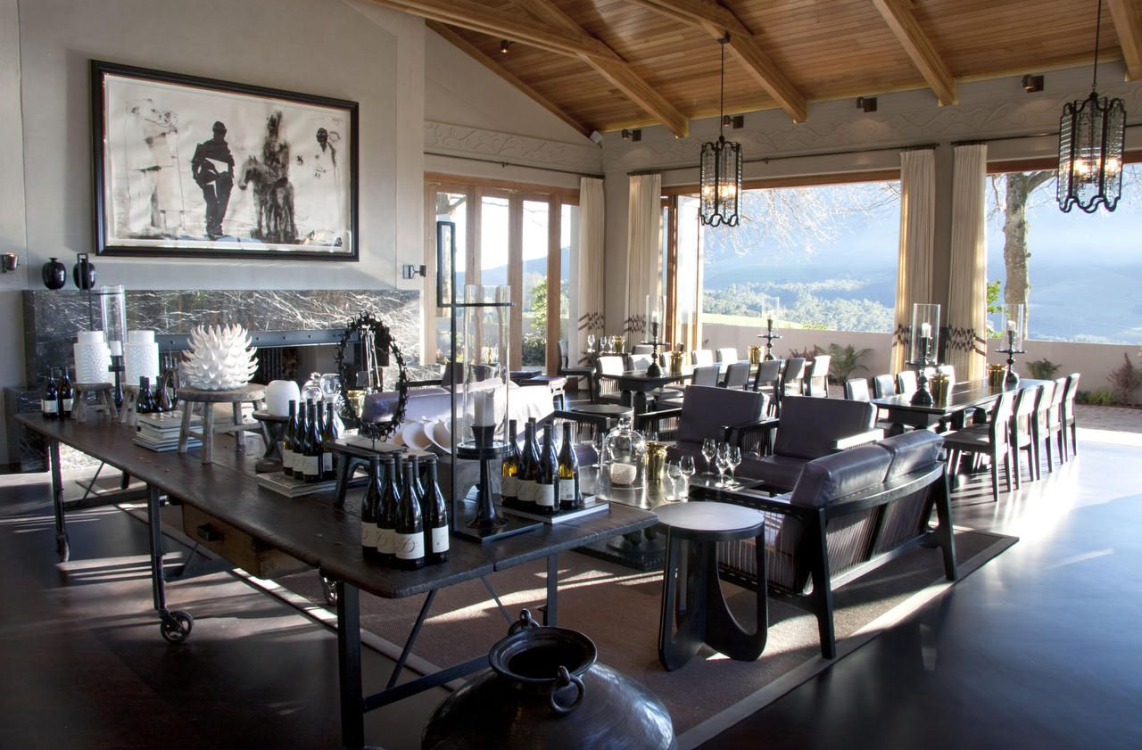 dining room at delaire graff overlooking the beautiful cape winelands on a sunny day