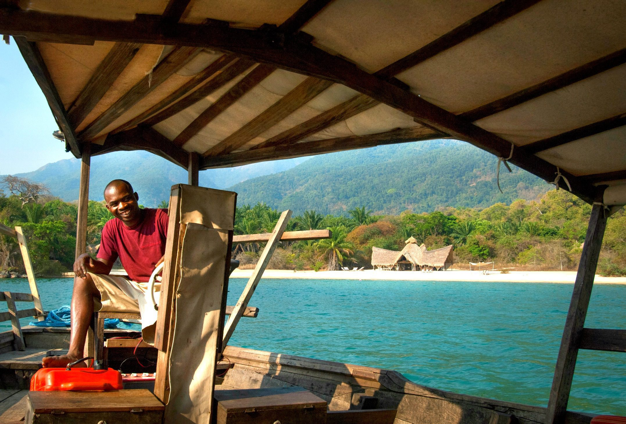 dhow ride safari driver in water en route to mahale
