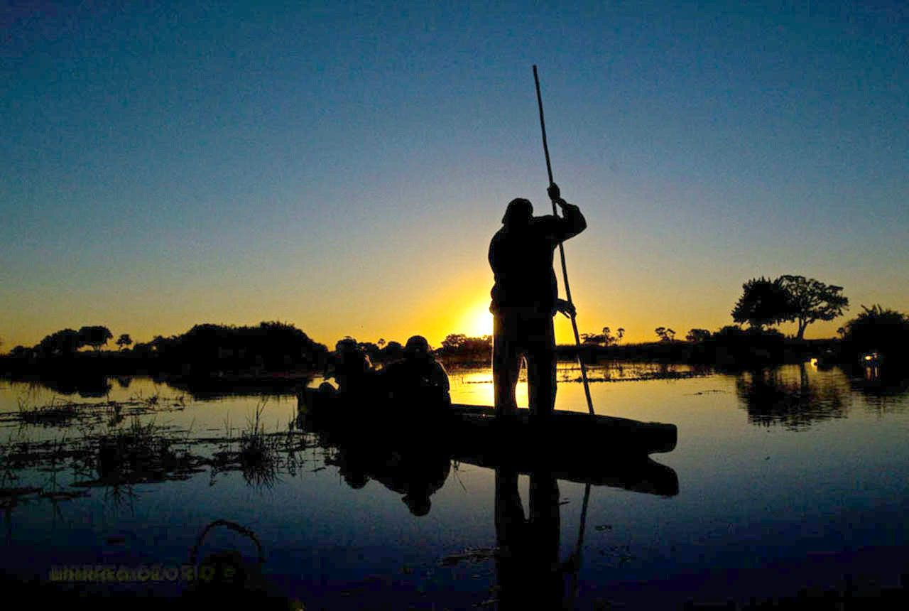 mokoro safari at Jacana Safari Lodge - Okavango Delta, Botswana at sunset