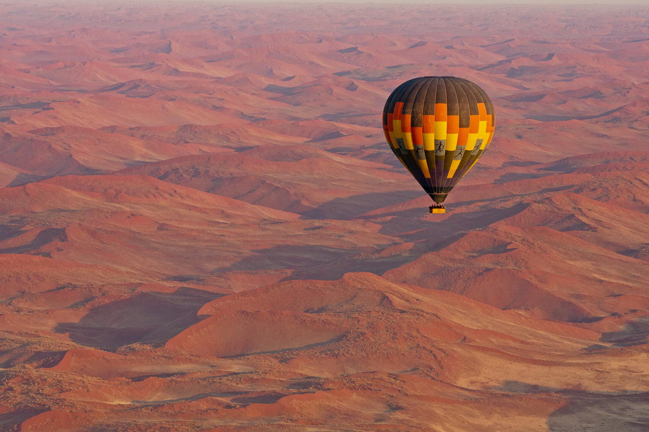 Hot air balloon over sossusvlei and namib desert