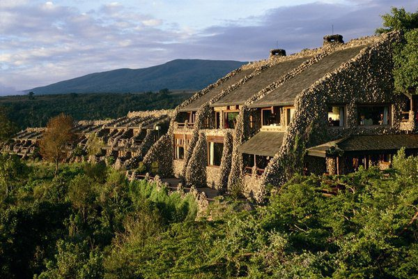 stone cottages along the lush green rim of the Ngorongoro Crater