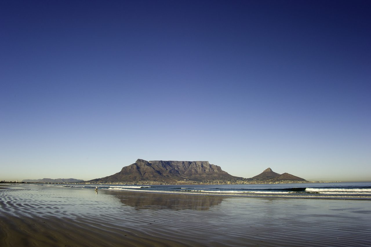 table mountain and ocean seen from Robben Island on this Southern Africa safari
