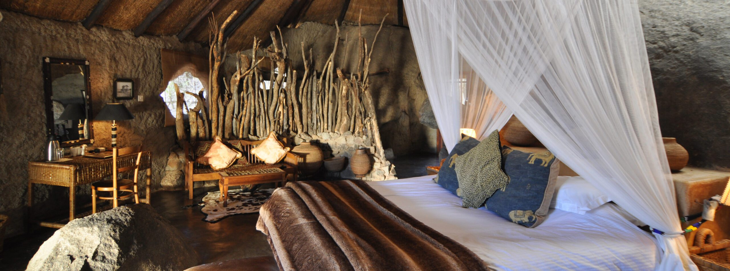 stay in this bedroom built into the rocks at Amalinda in Matobo HIlls on our Zimbabwe safari