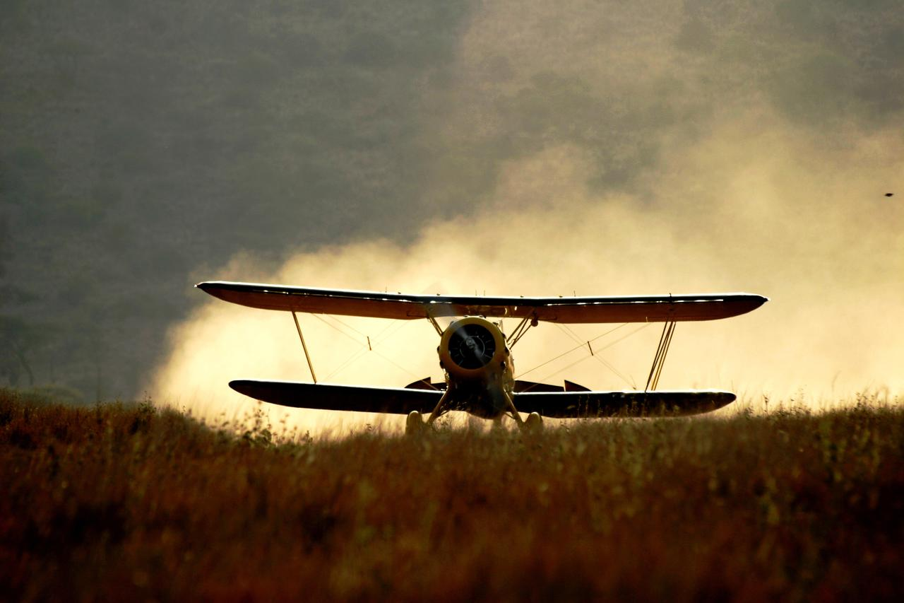owner of lewa wilderness on the ground during a luxury kenya safari biplane travel