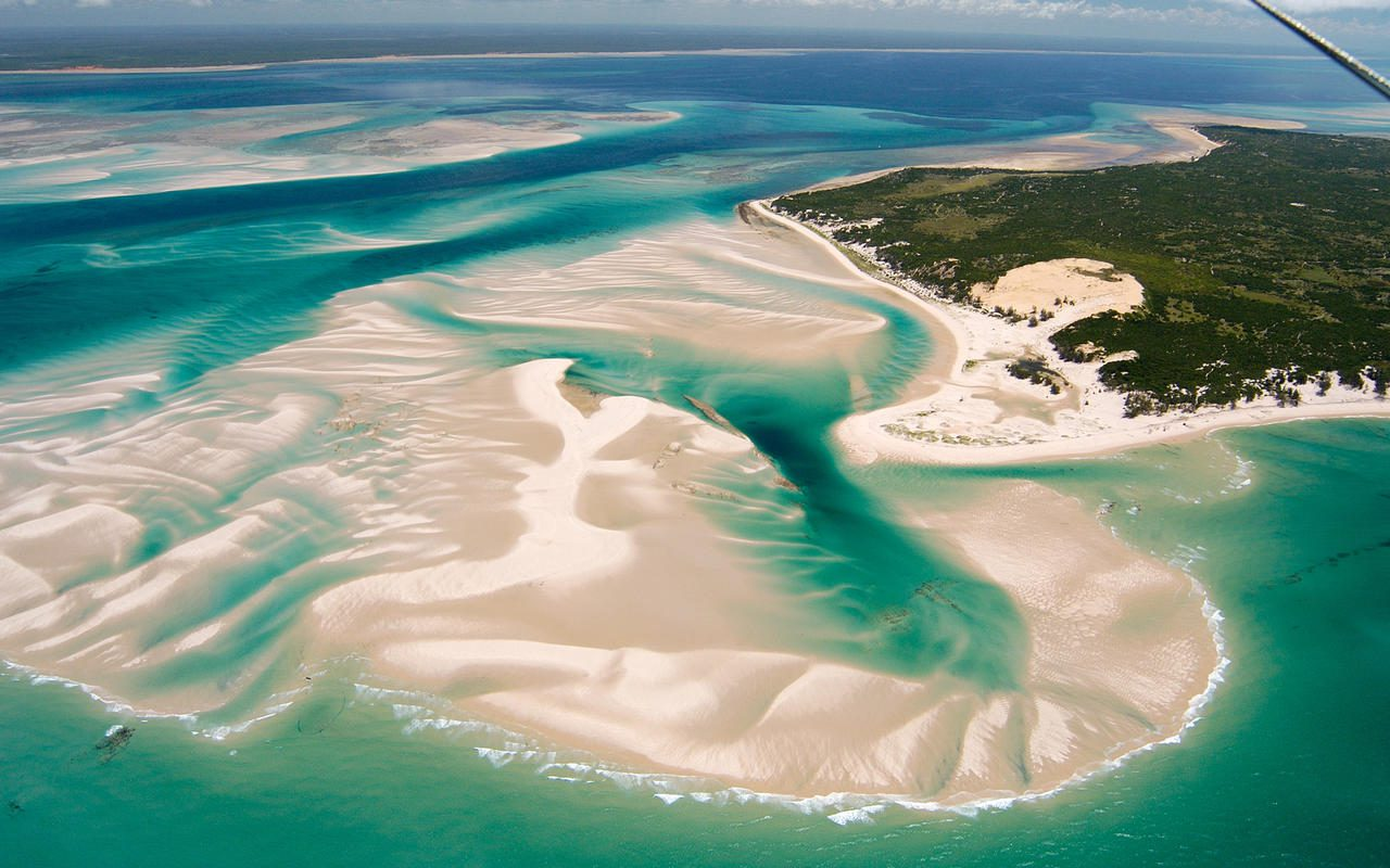 aerial photo of Benguerra Island featuring winding white sand and turquoise water.