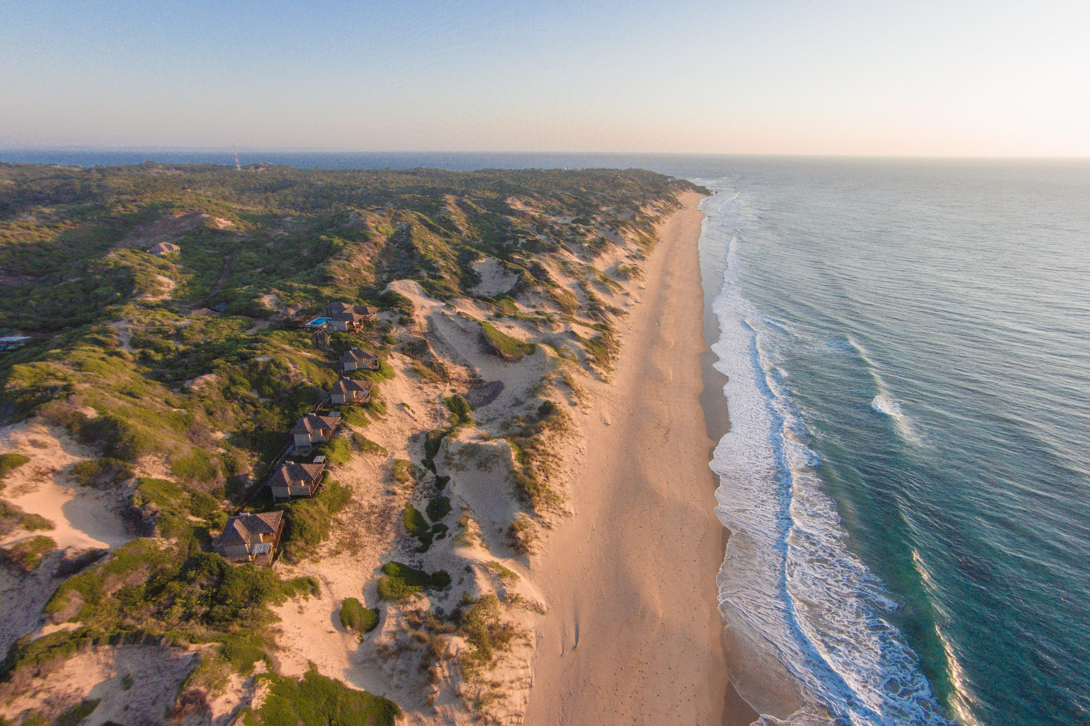 sandy and busy coastline of Sava Dunes in Inhambane