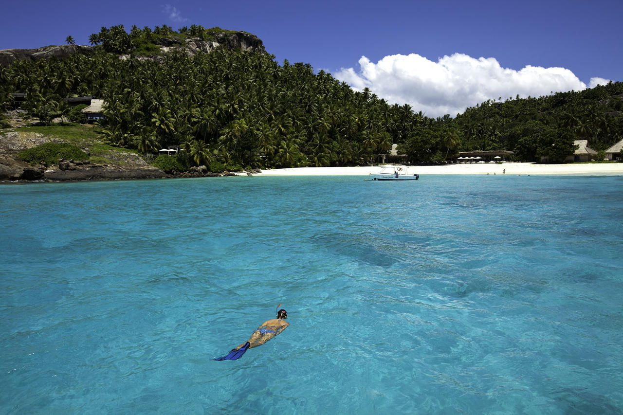 woman snorkeling off beach