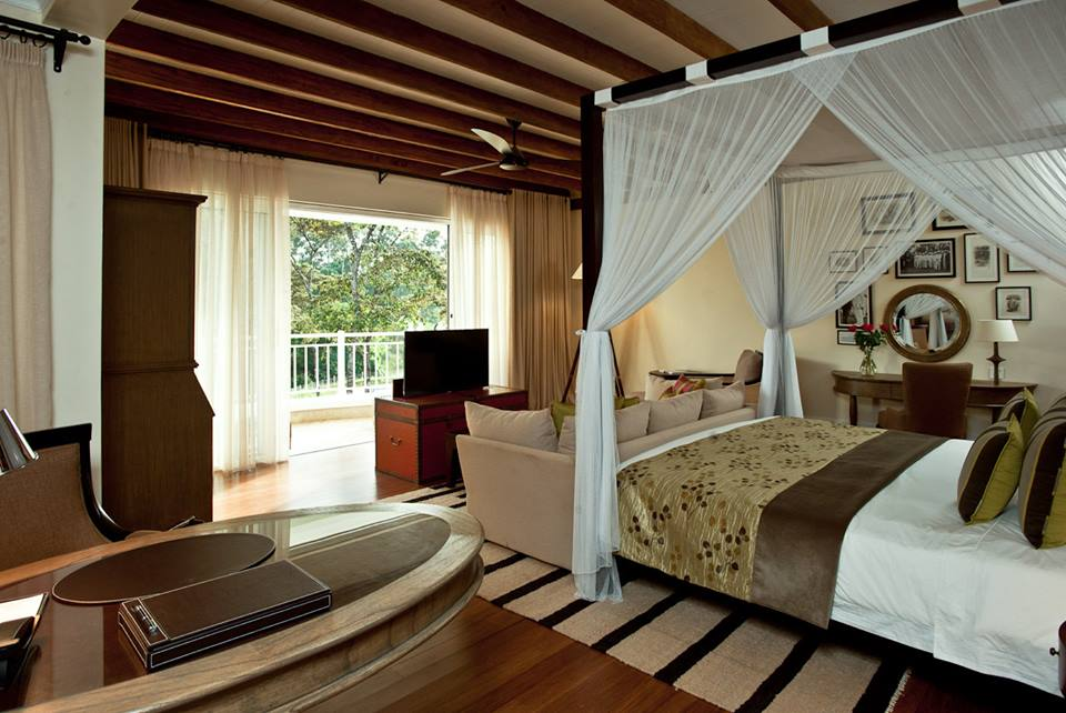 on your kenya safari view hemingways nairobi interior room view of bed leading out to the balcony
