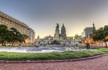 City scape of congress square in downtown Buenos Aires with statue and capitol building