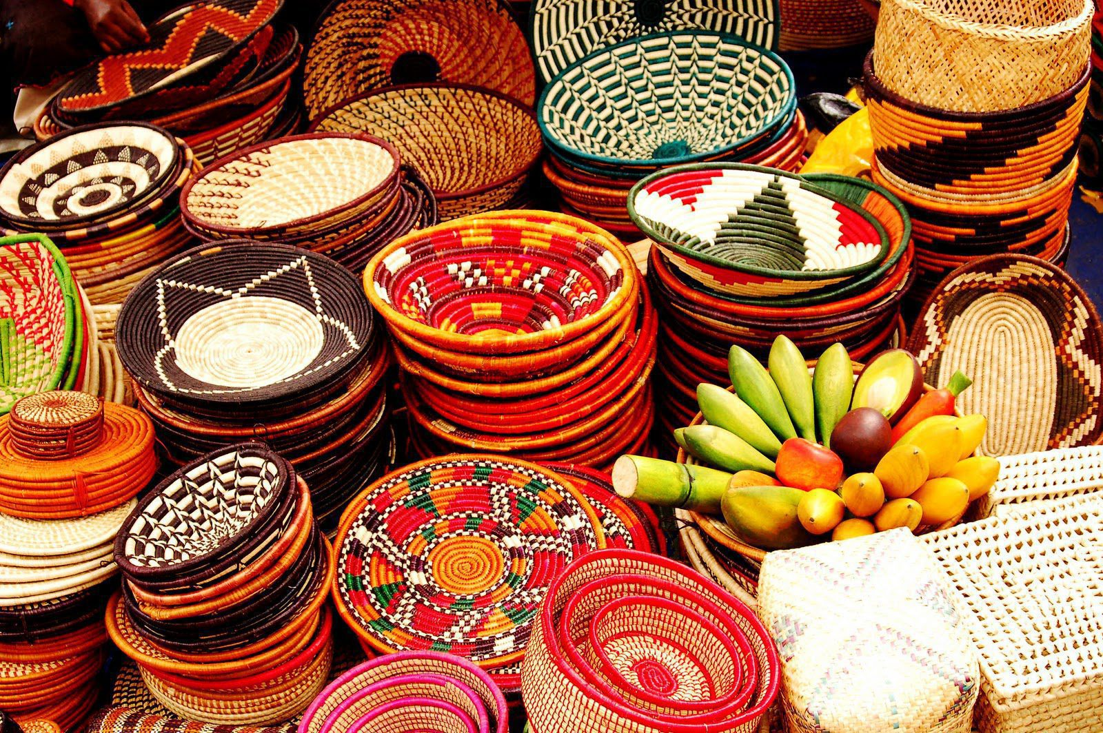 colorful baskets stacked up at a market