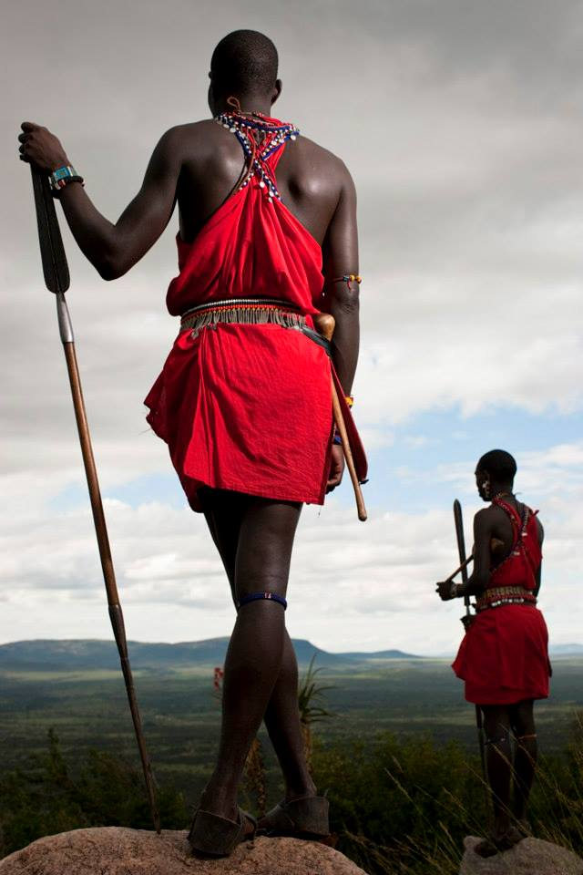 Two Maasai overlooking landscape