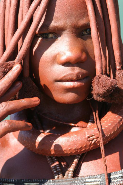 Himba girl with red ochre in hair and on skin