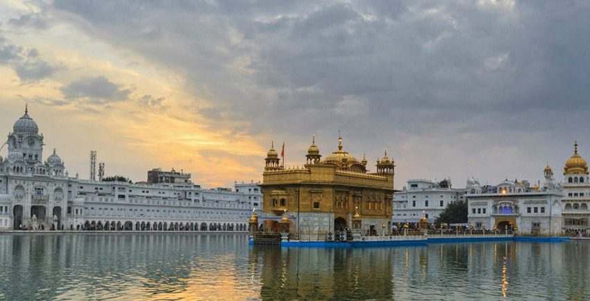 Golden Temple in Amritsar reflecting in the lake at dusk
