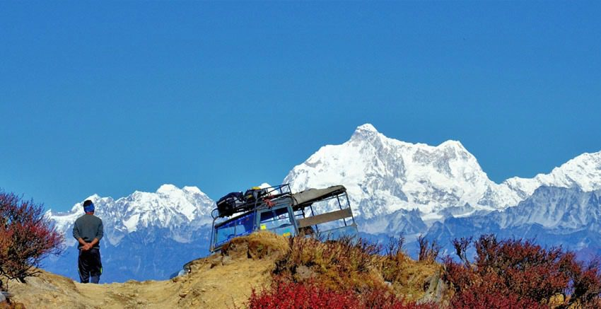 off-road vehicle in Singalila Naitonal Park in Darjeeling with the Himalayas in the background