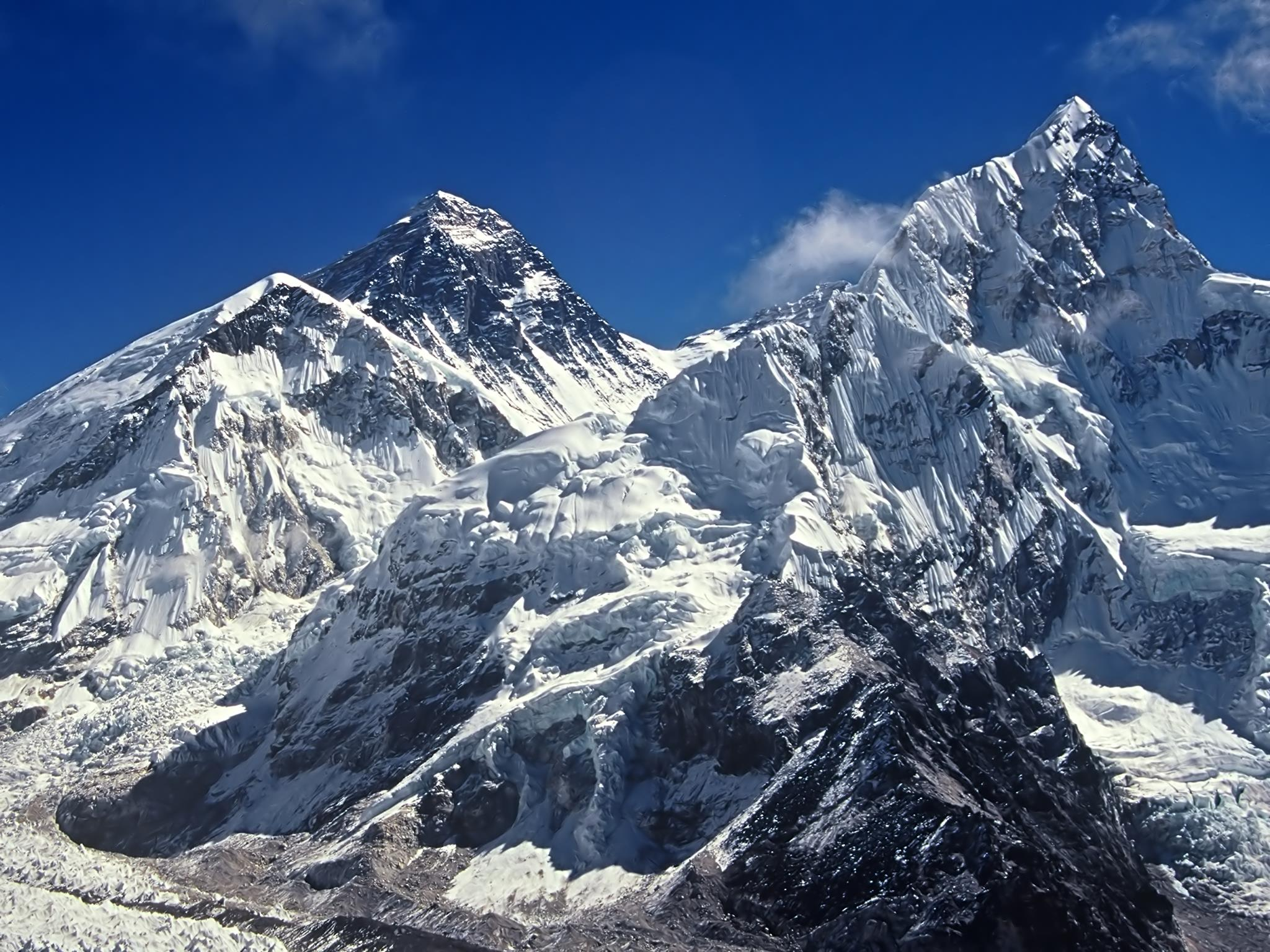 on this Nepal holiday you can view Mt. Everest and the surrounding mountains against a bright blue sky