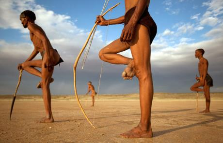 san bushmen standing with bows