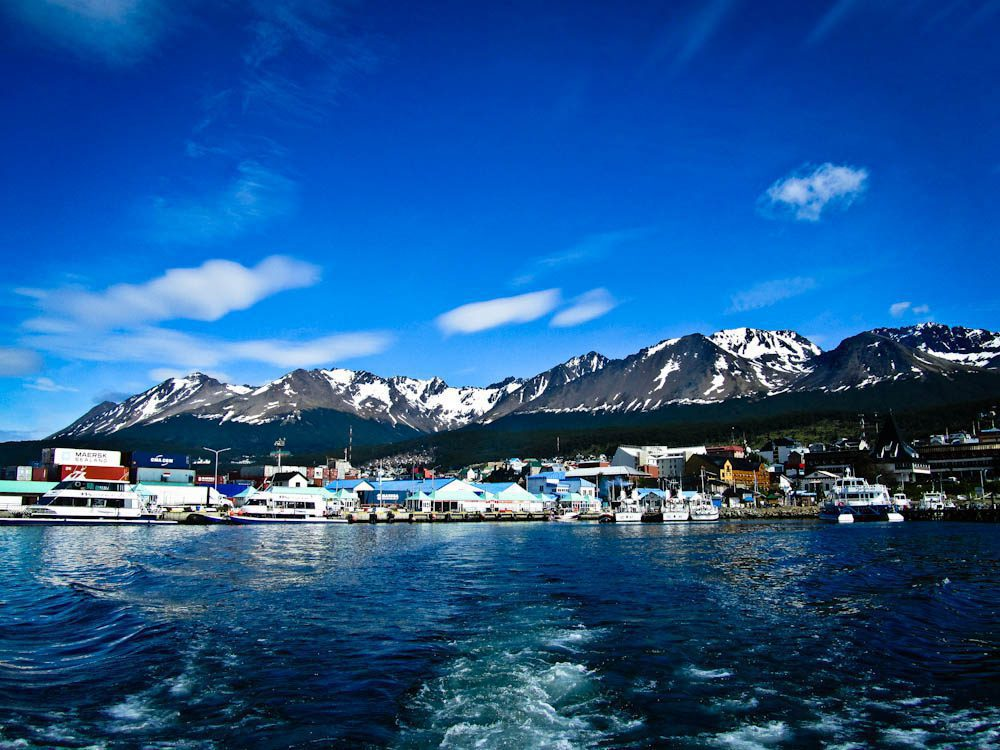 port town of Ushuaia and the mountains behind it, seen from the water.