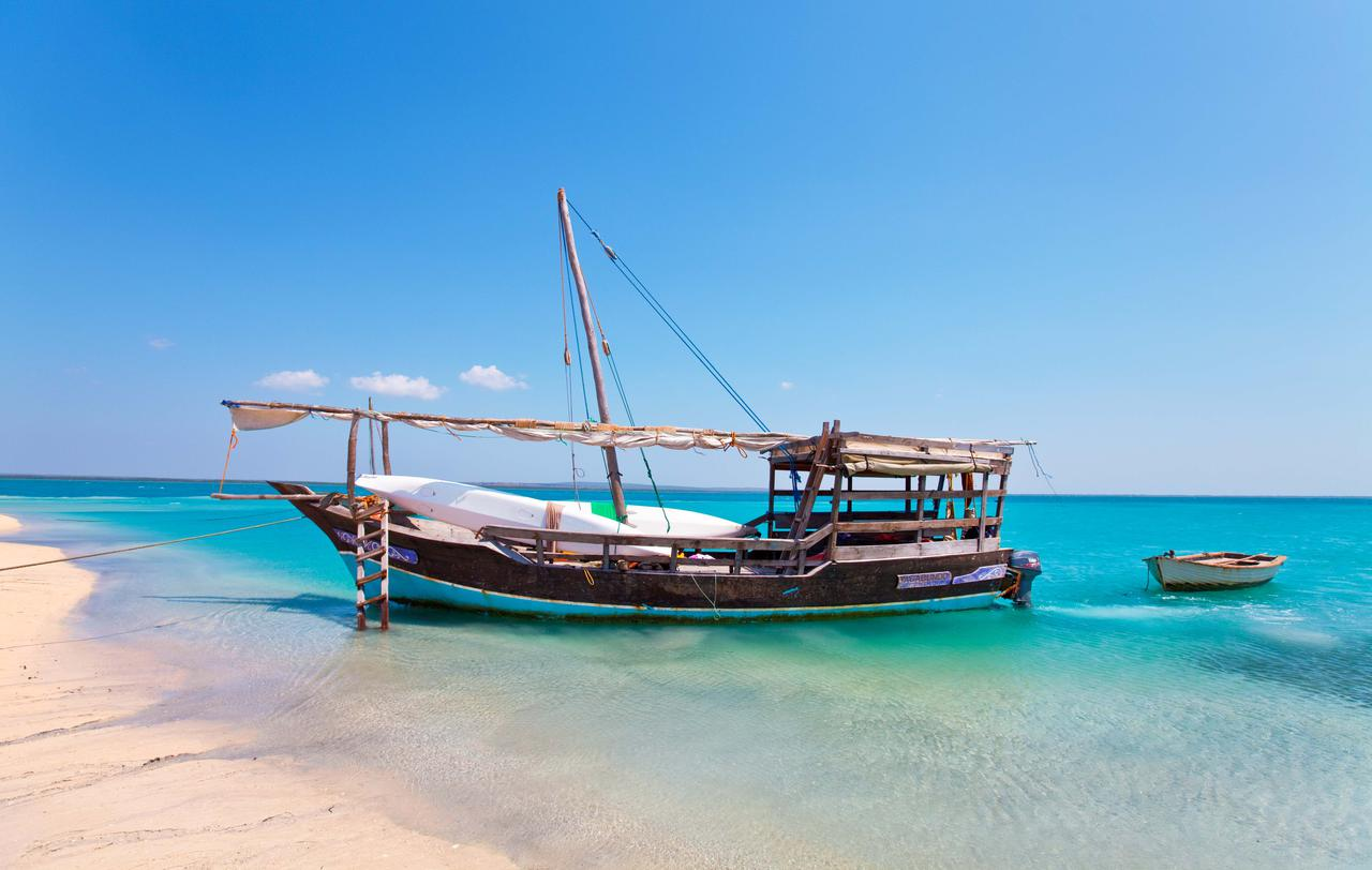 dhow ride vacation at Ibo Island Lodge on turquoise waters
