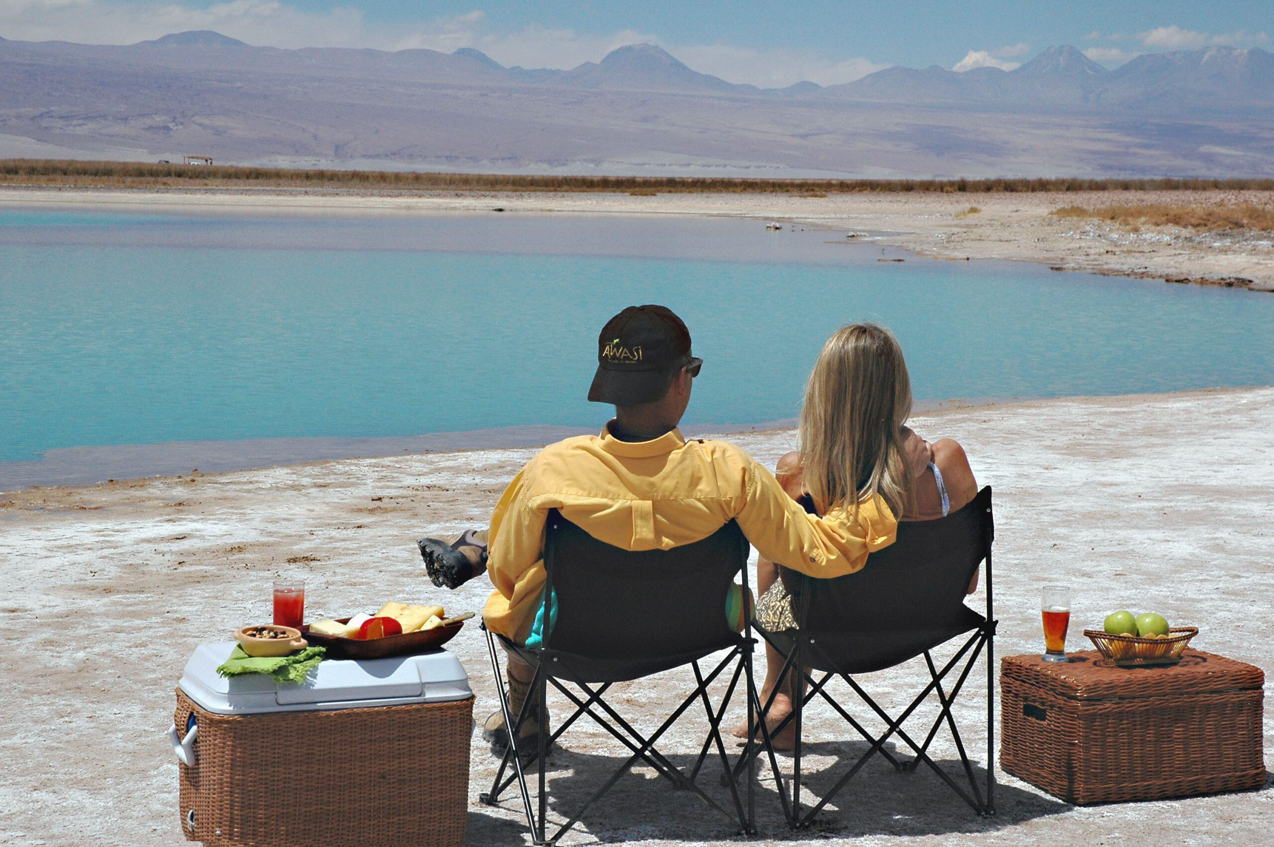 two people stopping for snacks overlooking a lake in the Atacama desert on Argentina & Chile tour