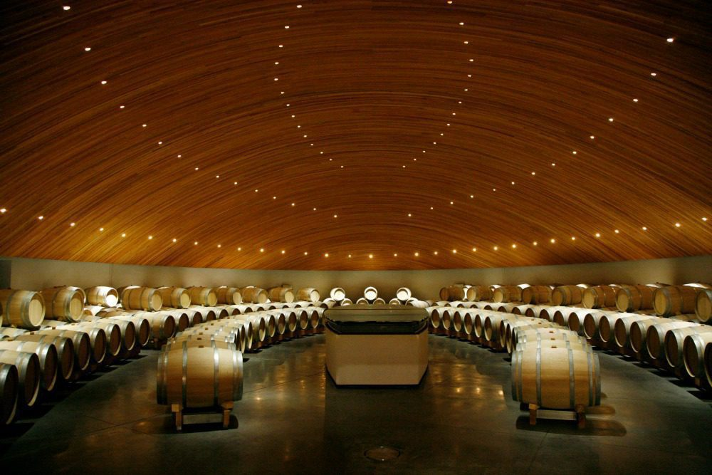 tasting room at lapostolle is under a wood roof with lights looking like constellations on this Chile holiday
