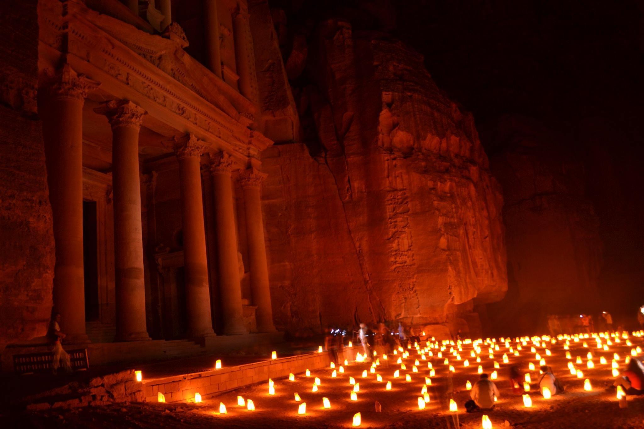 the treasury at petra lit by candles at night