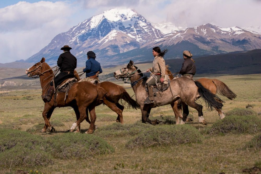 Gauchos on horseback riding through Torres del Paine. Awasi is a luxury hotel in patagonia on Argentina & Chile tour