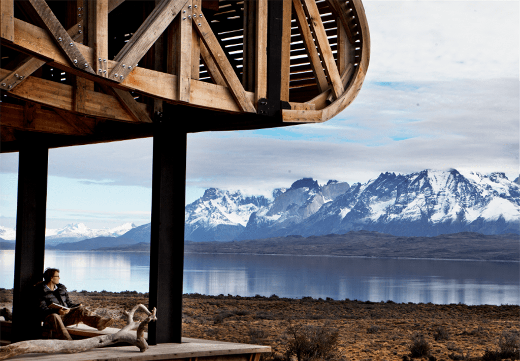 unique roofline overlooking a lake and snowy mountains in patagonia on Chile tour