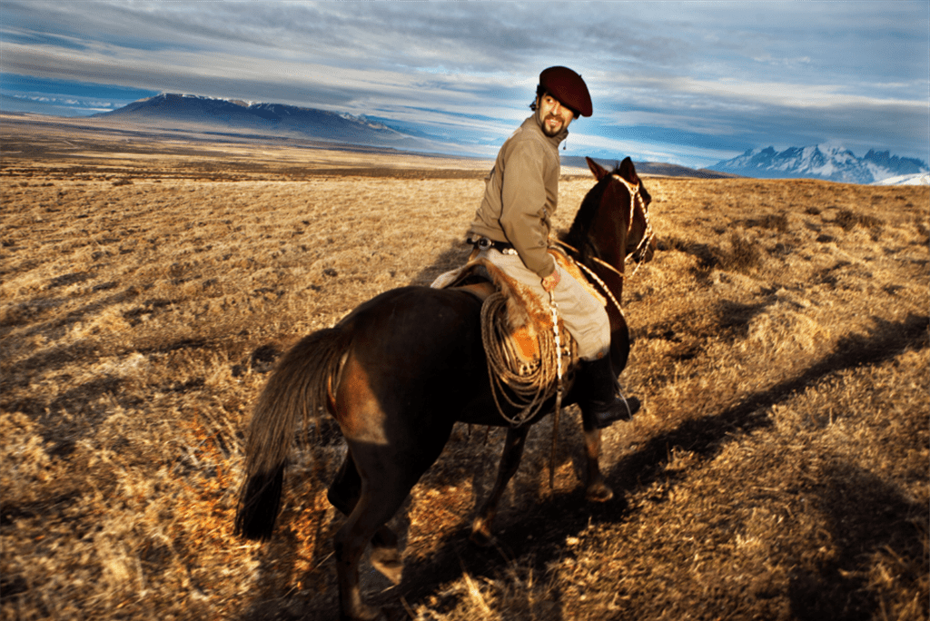 man on a horse on open plains in Patagonia