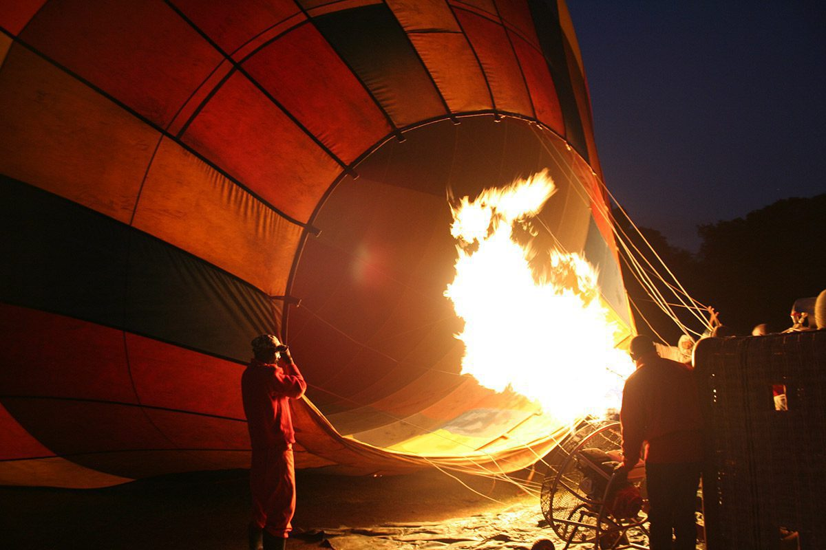 Angama Mara - Maasai Mara, Kenya - balloon being inflated before sunrise