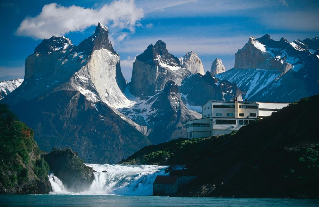 The dramatic peaks of Torres del Paine with gushing water below