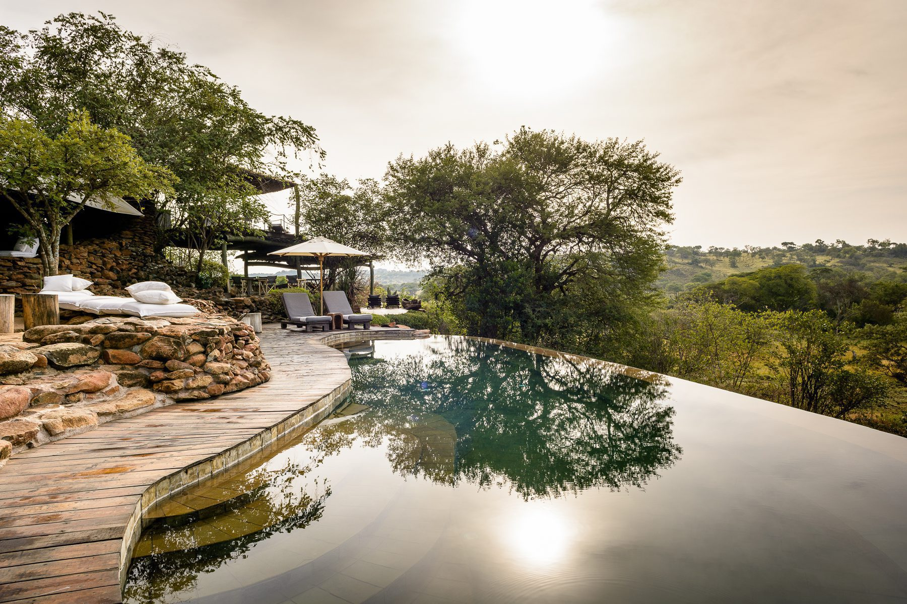 infinity pool and deck at Faru Faru Lodge on this Africa migration luxury safari