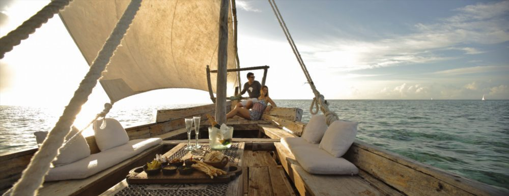 mnemba island dhow with champagne and snacks on a boating safari