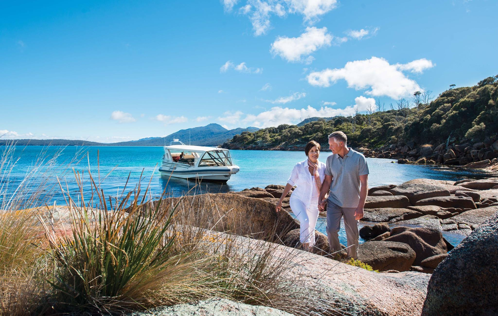 two people getting out of a boat at saffire freycinet, tasmania on Australia self-drive tour