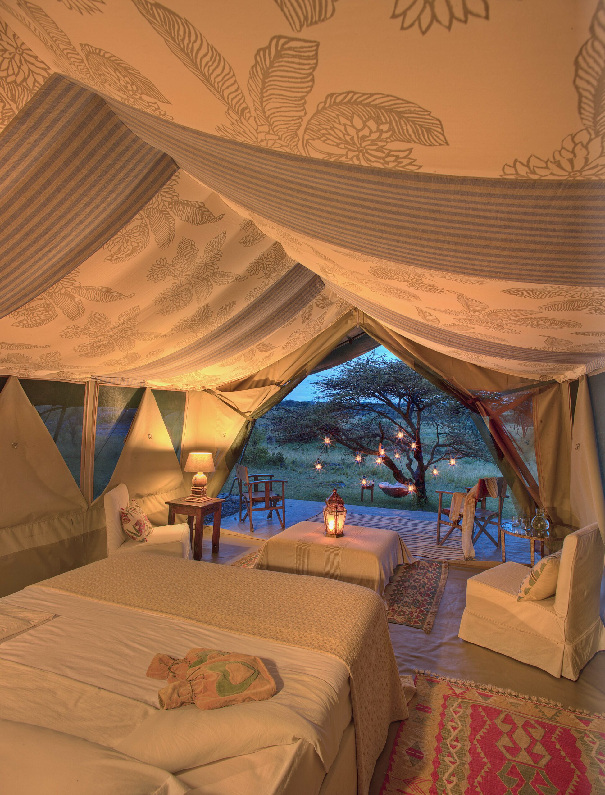 lovely white interior decor of a RIchard's River Camp tented room