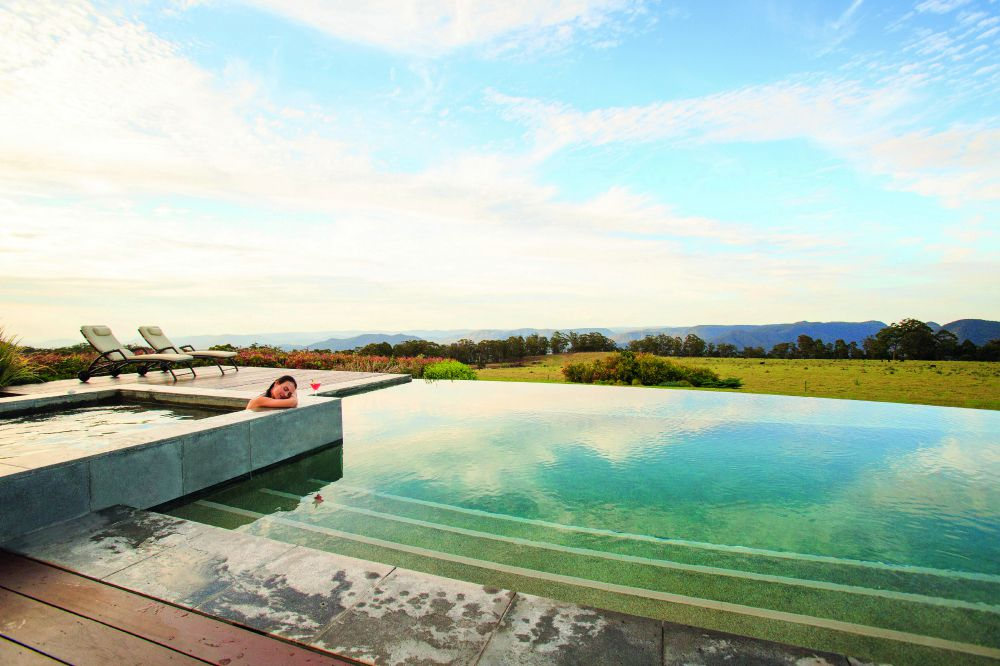 seen on Australia holiday is a woman enjoying pool looking out to the mountains
