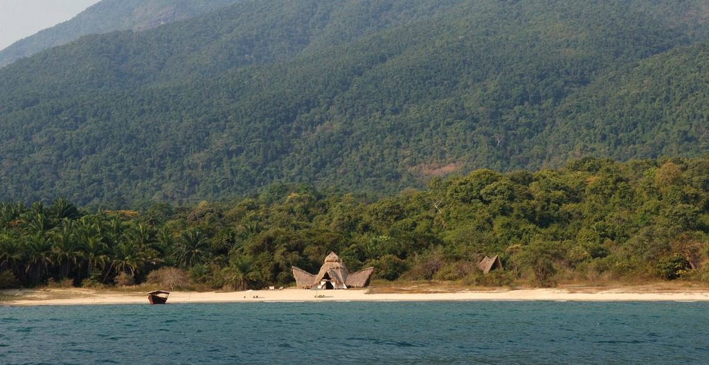 views from Lake Tanganyika of Greystoke Mahale on the beach with the Mahale Mountains behind