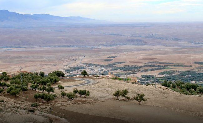 Agafay Desert hills and Atlas Mountains beyond