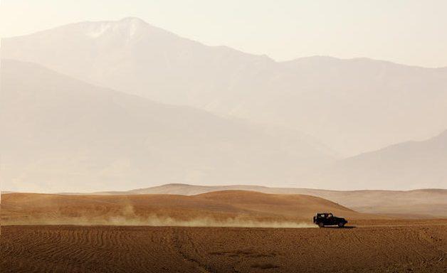 Jeep driving through Agafay Desert