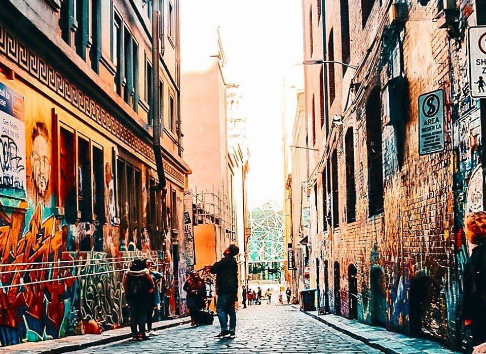Man soaks in the graffiti in Melbourne's hidden laneways
